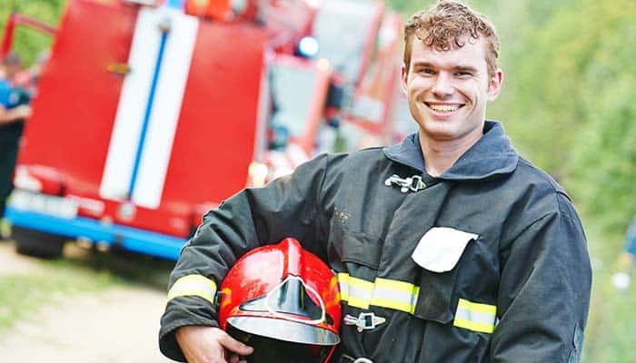 Firefighter in front of his firetruck